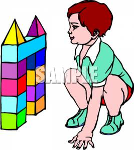 267x300 A Child Playing With Colored Building Blocks
