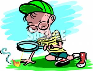 300x229 A Boy Making Fire With A Magnifying Glass Clipart Picture