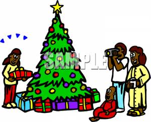 300x243 An African American Family Gathered Around A Christmas Tree Clip