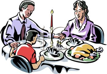 350x243 Picture of a Family At the Dinner Table On Christmas Praying For