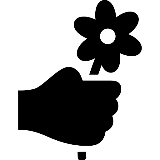 Hand Holding Up A Flower