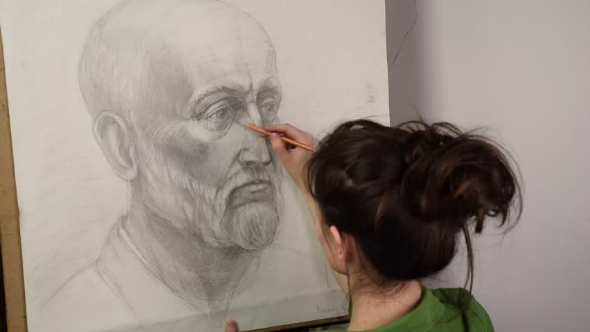 852x480 girl artist drawing a portrait with a pencil on a drawing lesson