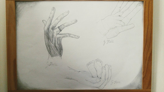 570x321 Hands. Adult Father's Hand Baby Feet Mother