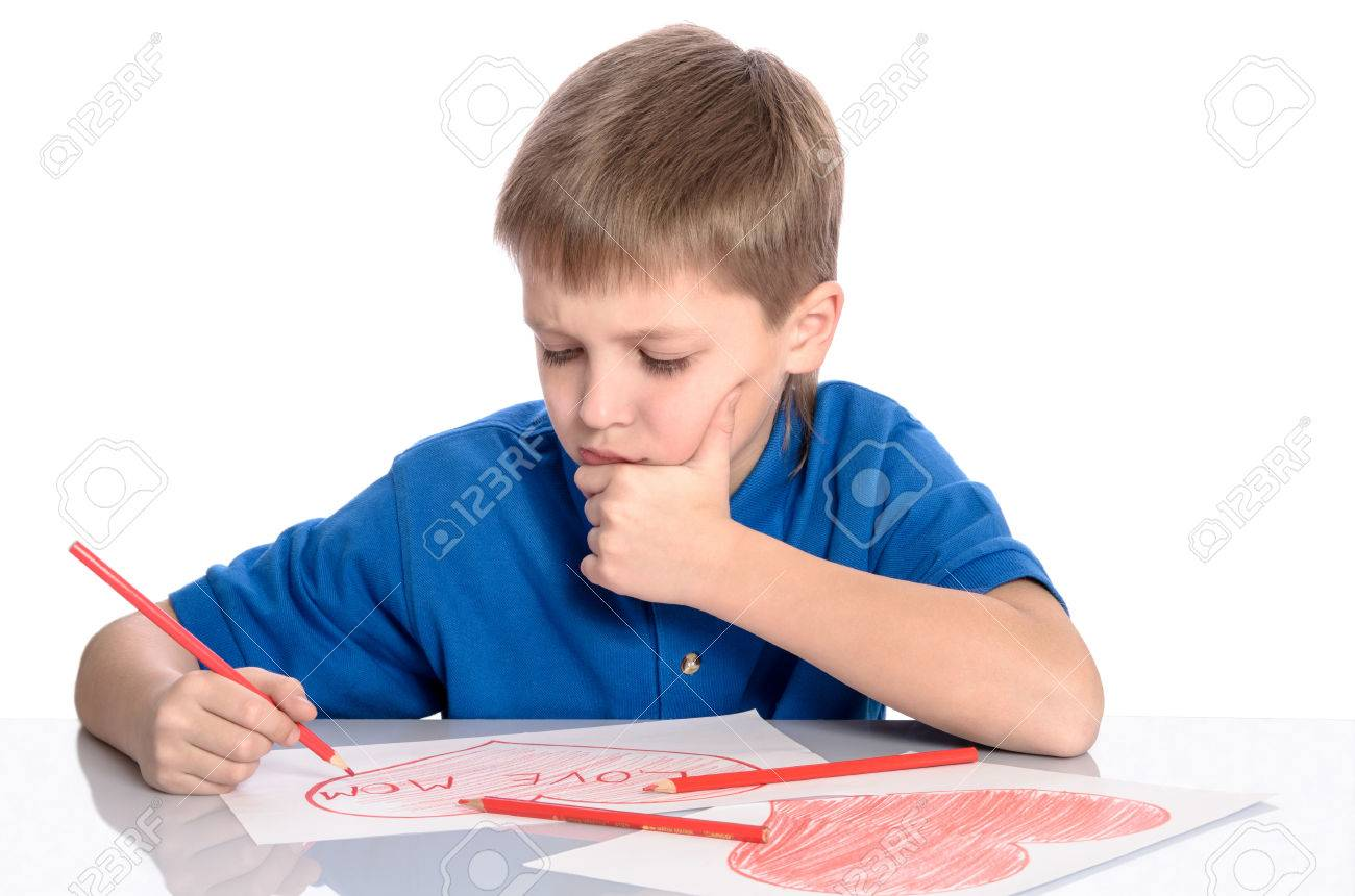 1300x860 Boy Drawing A Heart That Says I Love Mom Stock Photo, Picture