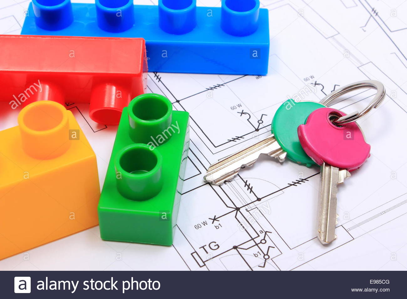 1300x954 Closeup Of Home Keys And Heap Of Plastic Colorful Building Blocks