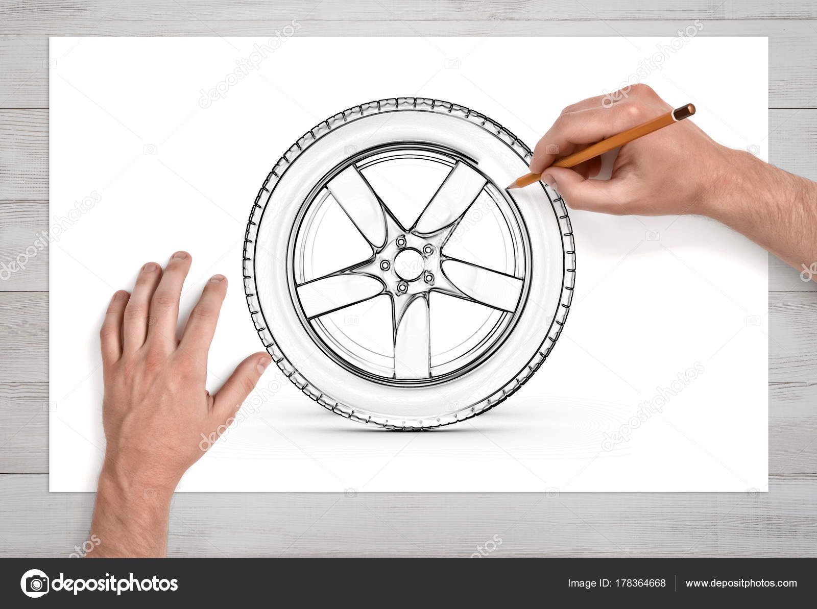 1600x1193 Two Male Hands In Close View As They Draw A Car Tire With A Pencil