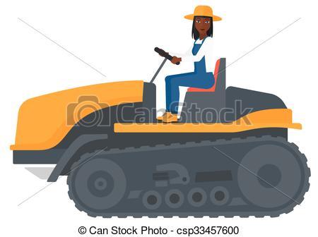 450x336 Farmer Driving Catepillar Tractor. An African American Vector