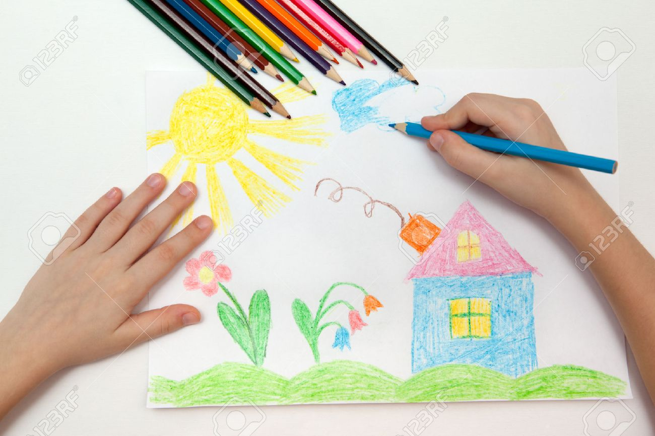 1300x866 Child Draws A Pencil Drawing Of The World Stock Photo, Picture