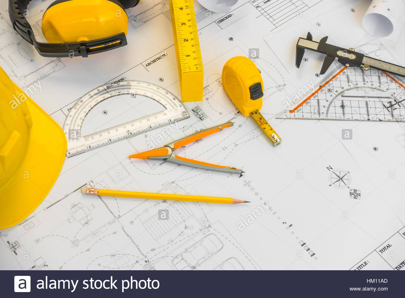 1300x956 Construction Plans With Yellow Helmet And Drawing Tools