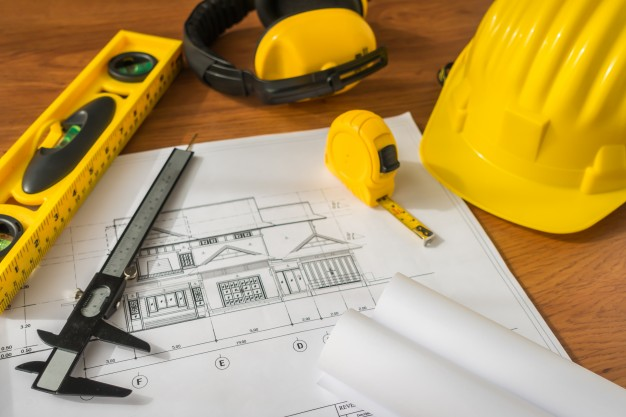 626x417 Construction Plans With Yellow Helmet And Drawing Tools On Bluep