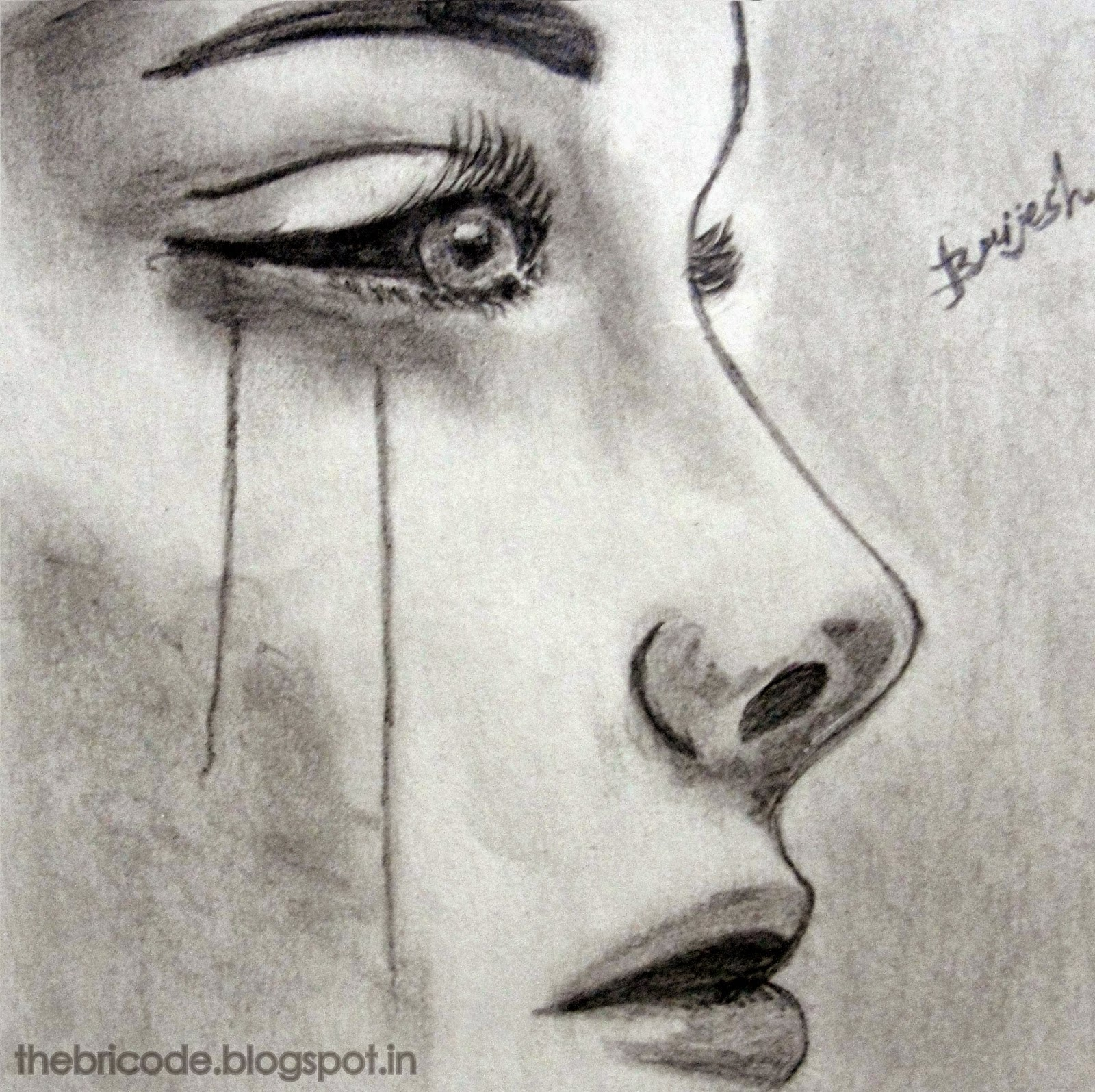 crying girl drawing