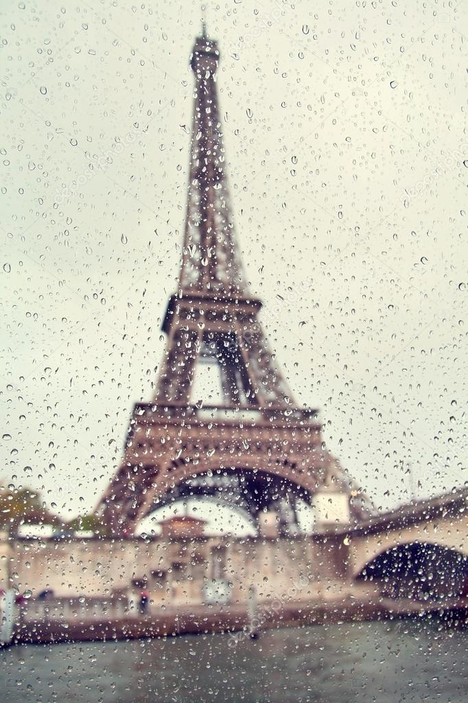 682x1023 View On The Eiffel Tower Through The Window With Rain Drops