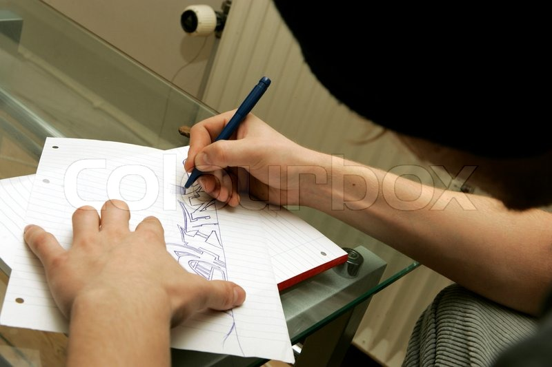 800x533 Teenager Drawing Grafitti On Paper Stock Photo Colourbox