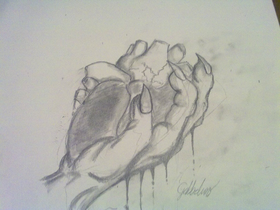 900x675 A Hand Holding A Human Heart By Gabbelino