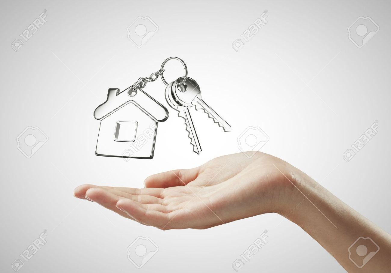 1300x910 Key With Key Chain On Hand On White Background Stock Photo