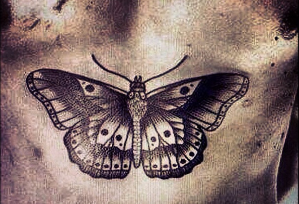 594x405 Check Out Harry Styles' Butterfly Chest Tattoo
