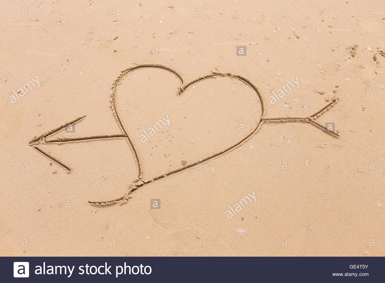 1300x956 Heart And Arrow Drawn In The Smooth Beach Sand. Love Concept Stock