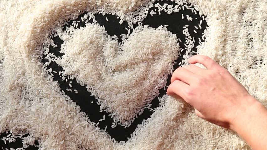 852x480 Man Hand Is Drawing A Heart On White Rice Stock Footage Video