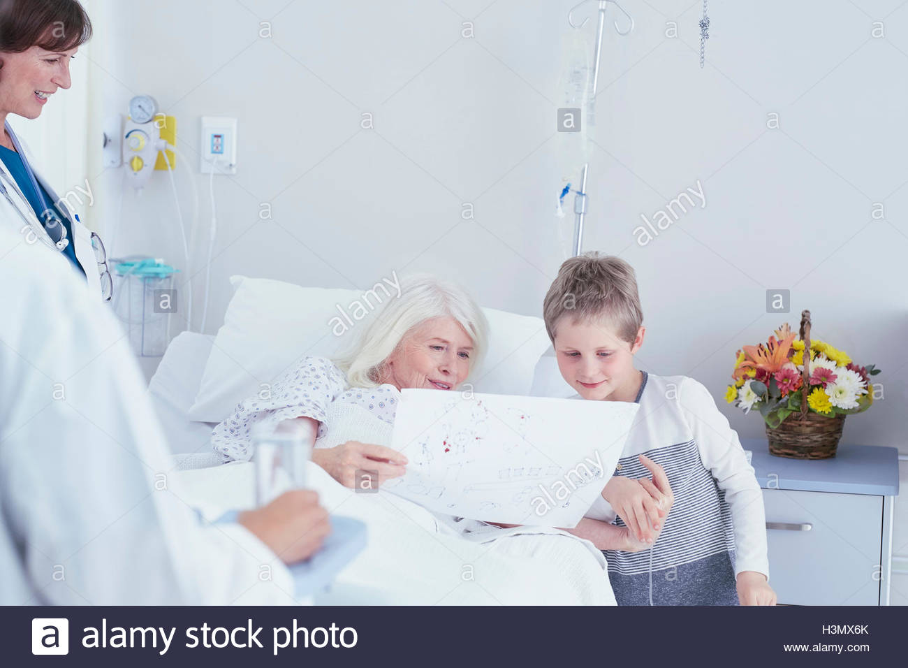 1300x956 Senior Female Patient In Hospital Bed Looking