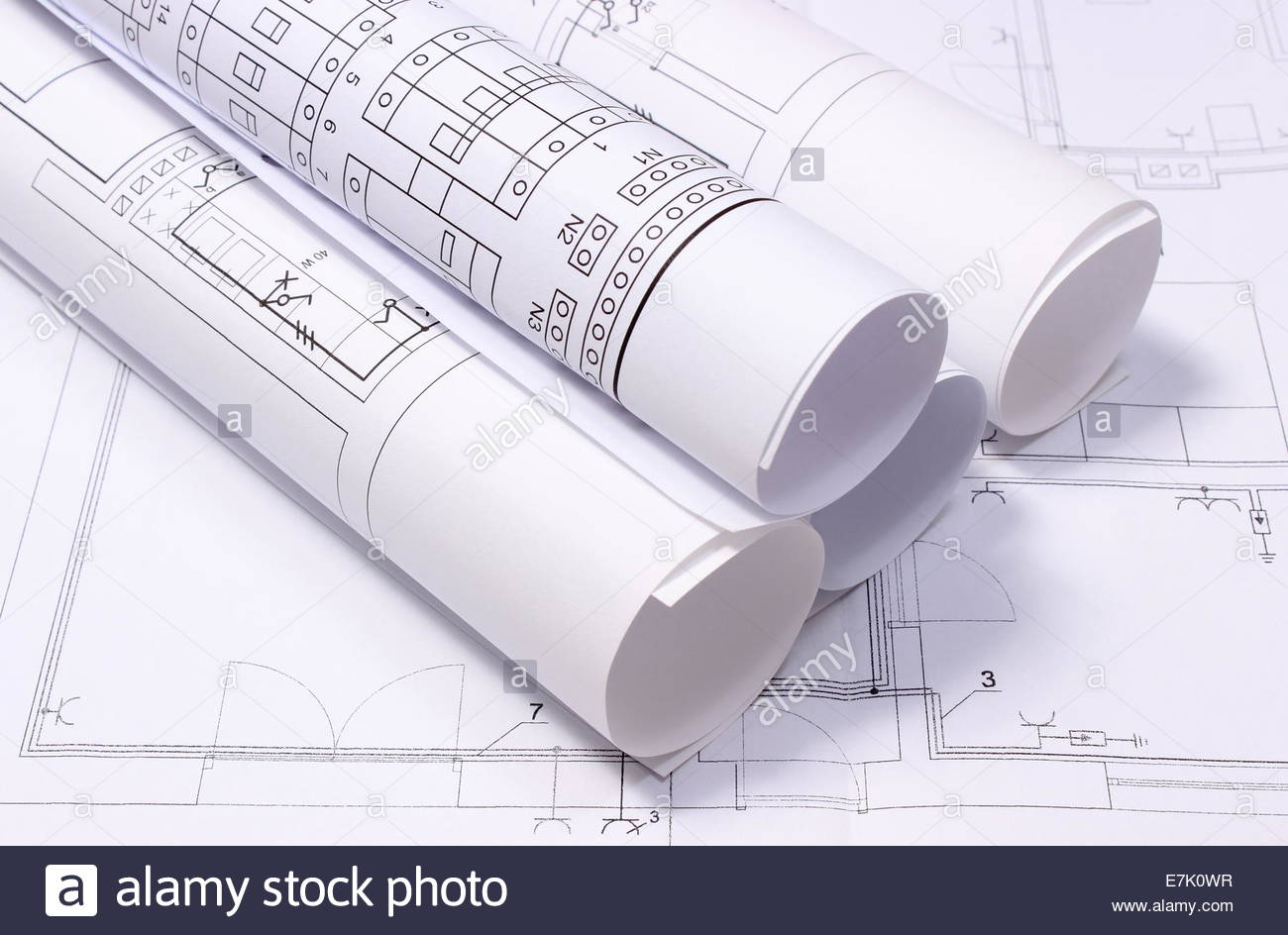 1300x944 Rolled Electrical Diagrams Lying On Construction Drawing Of House