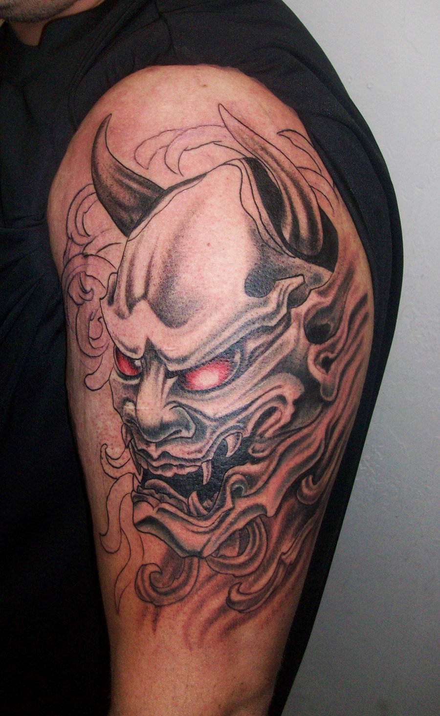 900x1466 35 Oni Mask Tattoos With Mysterious And Powerful Meanings