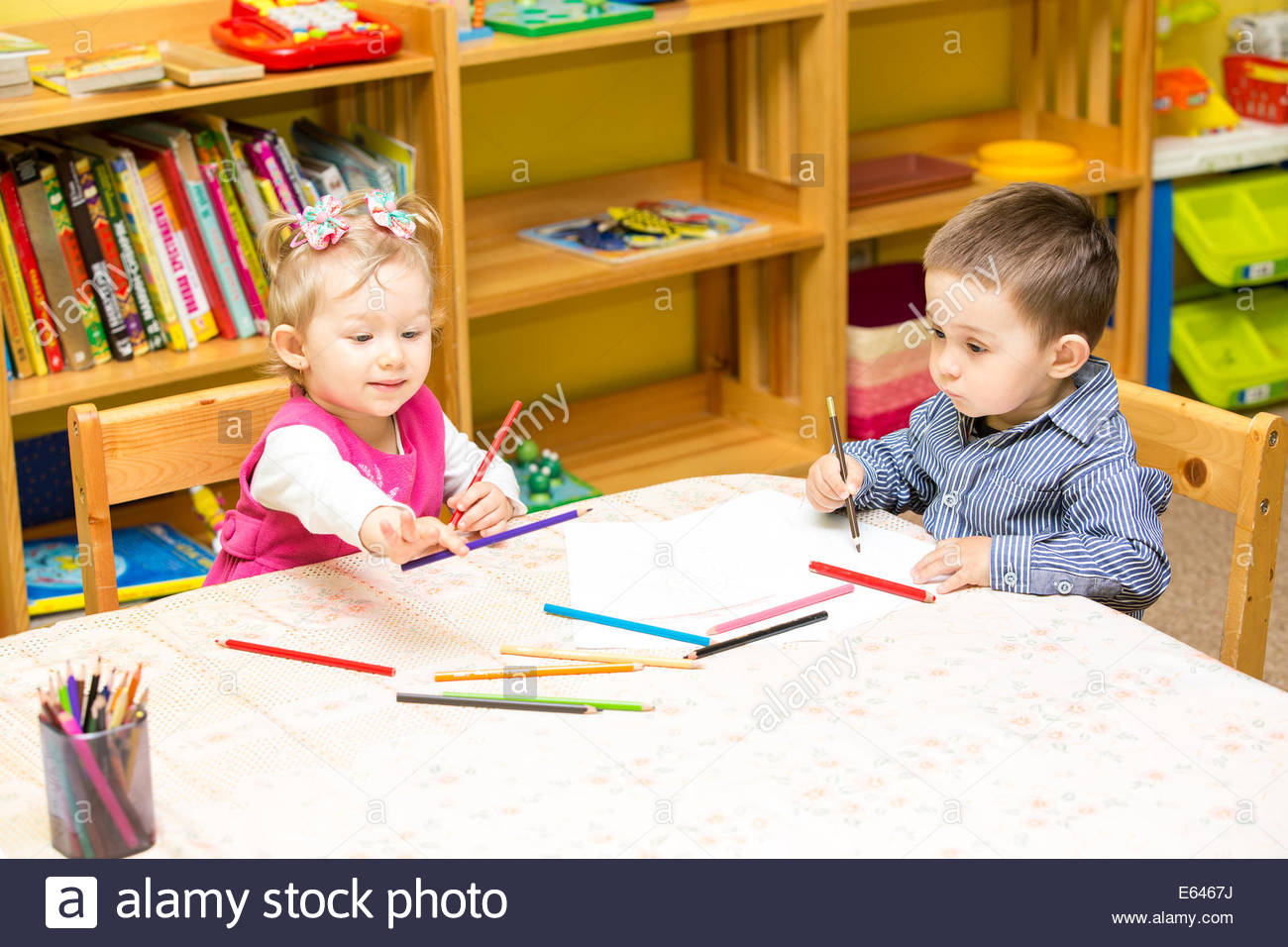 1300x956 Two Little Kids Drawing With Colorful Pencils In Preschool