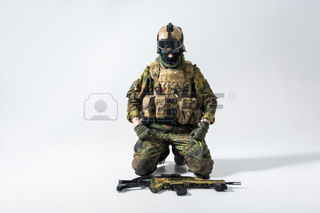 450x300 Kneeling Soldier Stock Photos. Royalty Free Business Images