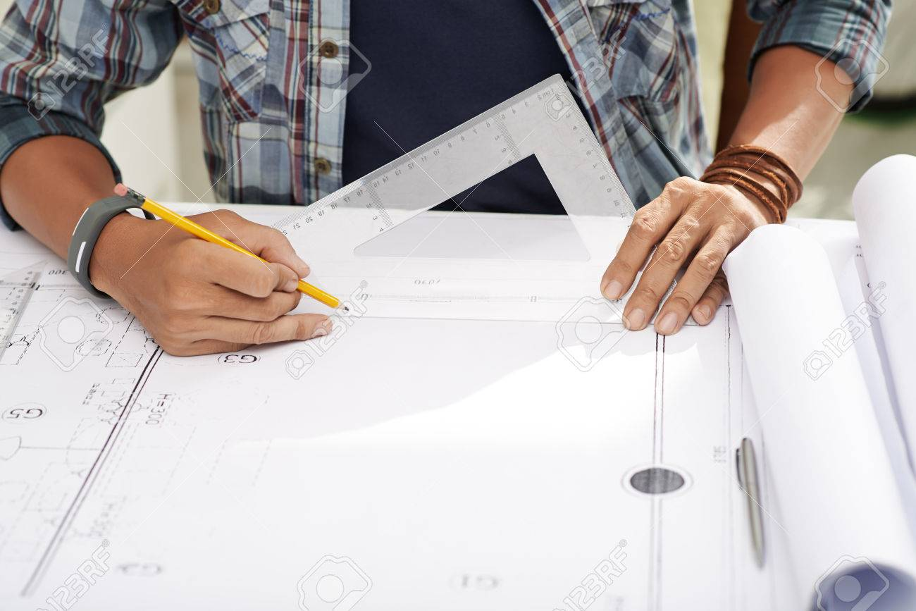 1300x867 Hands Of Architect Measuring Drawing Plan Of Building Stock Photo
