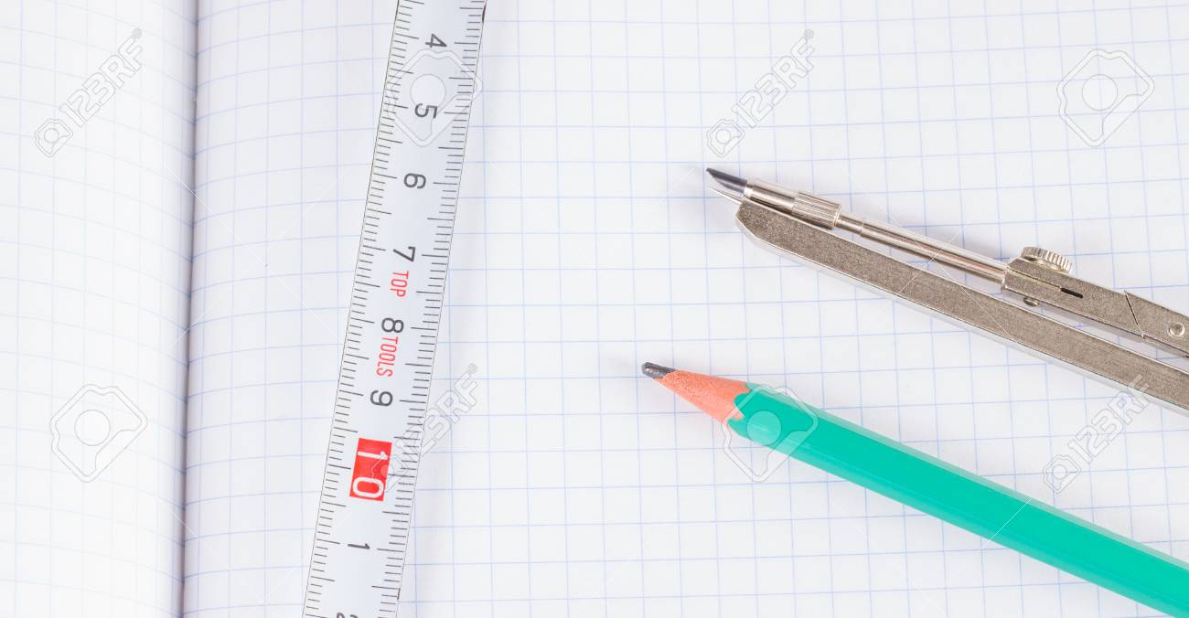 1300x676 Tools For Drawing And Measuring On A Sheet In A Cage Stock Photo