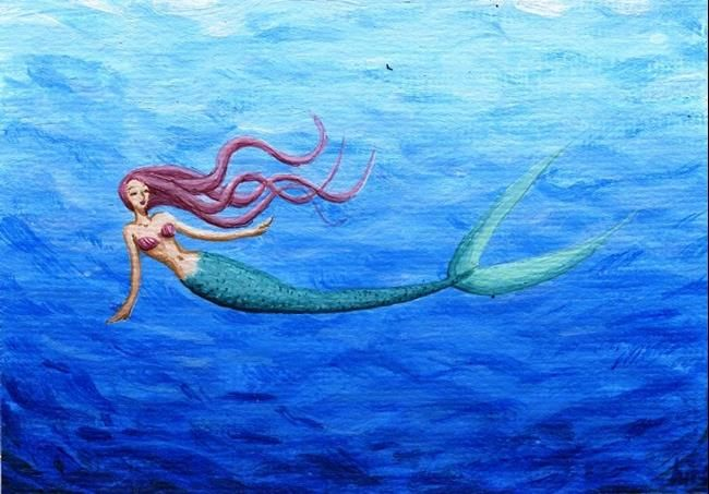 650x453 Mermaid Swimming
