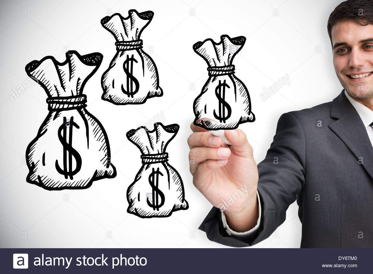 1300x956 Composite Image Of Businessman Drawing Money Bags Stock Photo