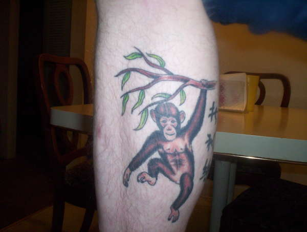 600x453 Monkey Hanging On Tree Tattoo On Leg Calf