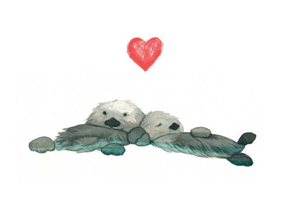 570x407 Sea Otters Holding Hands