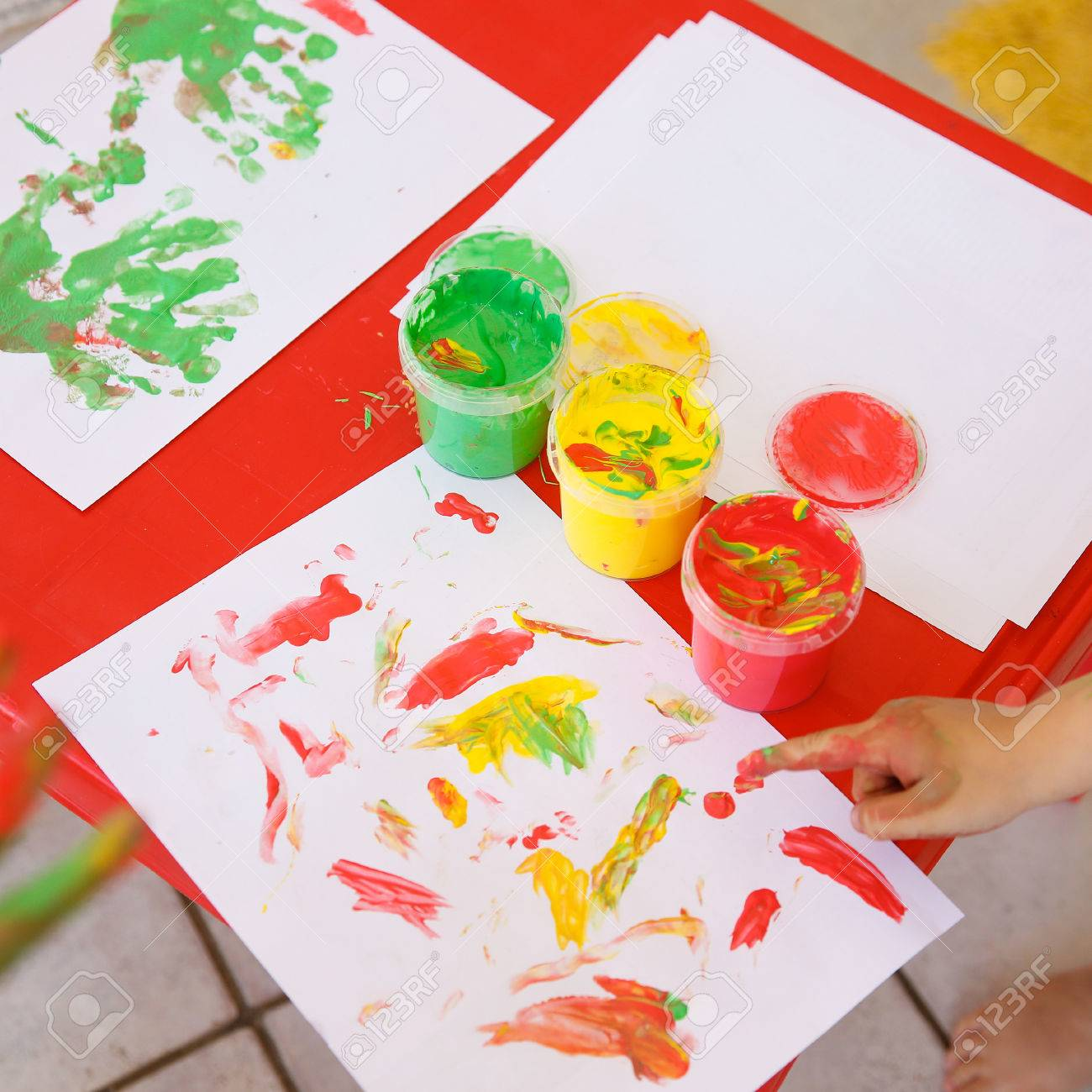 1300x1300 Child Painting A Drawing With Finger Paints, Used For Finger
