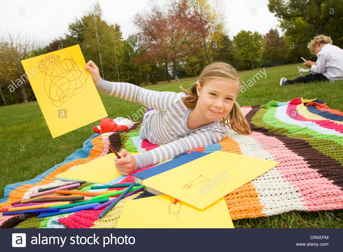 1300x956 Girl Drawing On Picnic Blanket Stock Photo 48986328