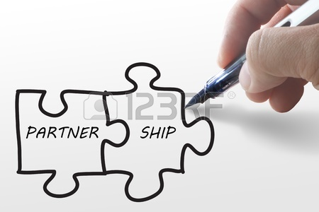 450x300 Partnership Written Puzzle Pieces In Hand Stock Photo, Picture