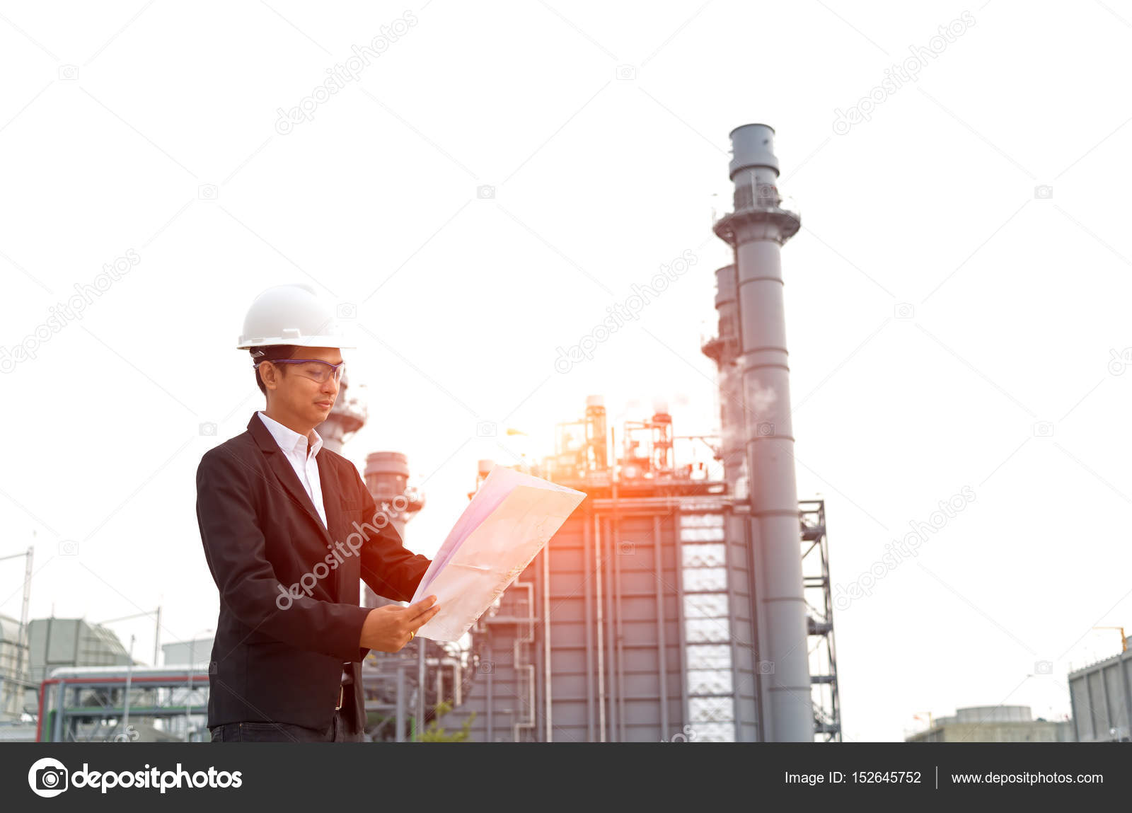 1600x1149 Engineer Wearing White Helmet Holding Paper Drawing With Oil