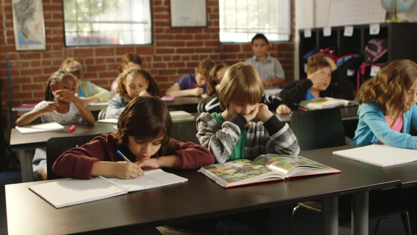 852x480 Young Elementary School Children In Classroom Drawing, Reading