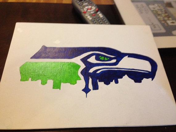 570x428 Seattle Seahawk Logo With Seattle Skyline Seattle Seahawks Logo