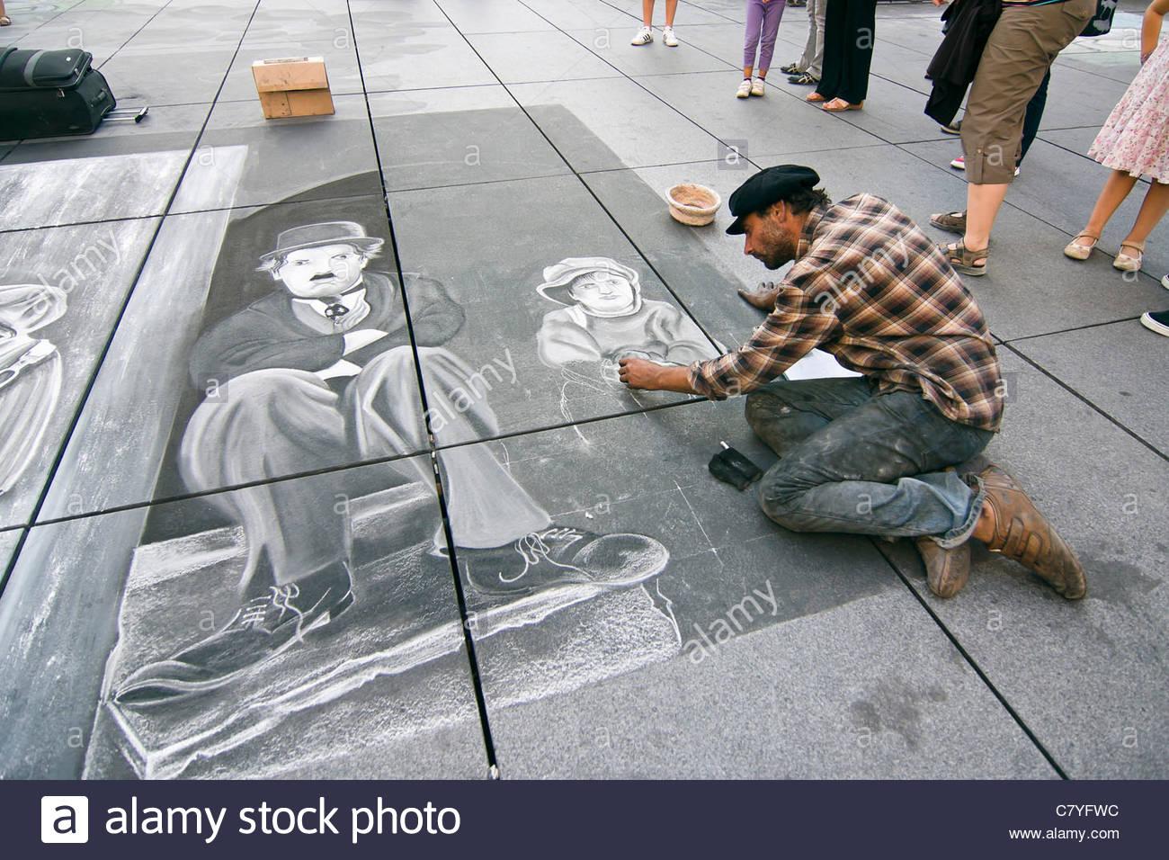 1300x956 A Street Artist Drawing Charlie Chaplin On The Sidewalk With Chalk