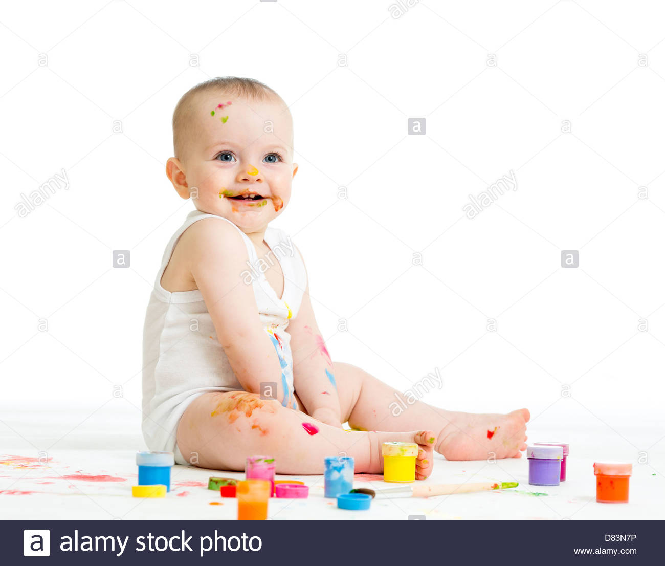 1300x1106 Smiling Baby Drawing With A Finger's Paints Stock Photo 56630890