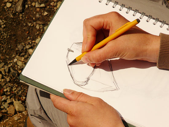 550x413 Gallery Image Of Someone Drawing,