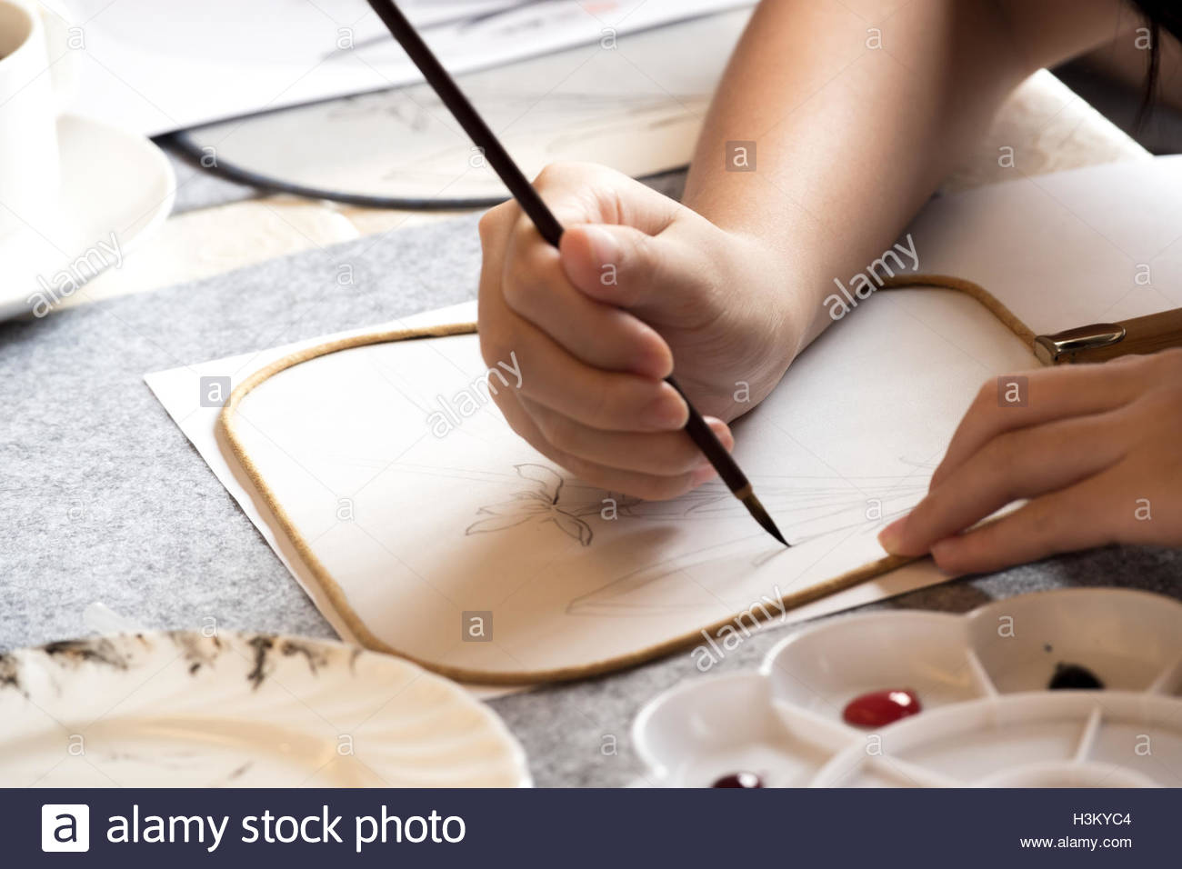 1300x956 Someone Drawing On Paper Fan Stock Photo 122755140