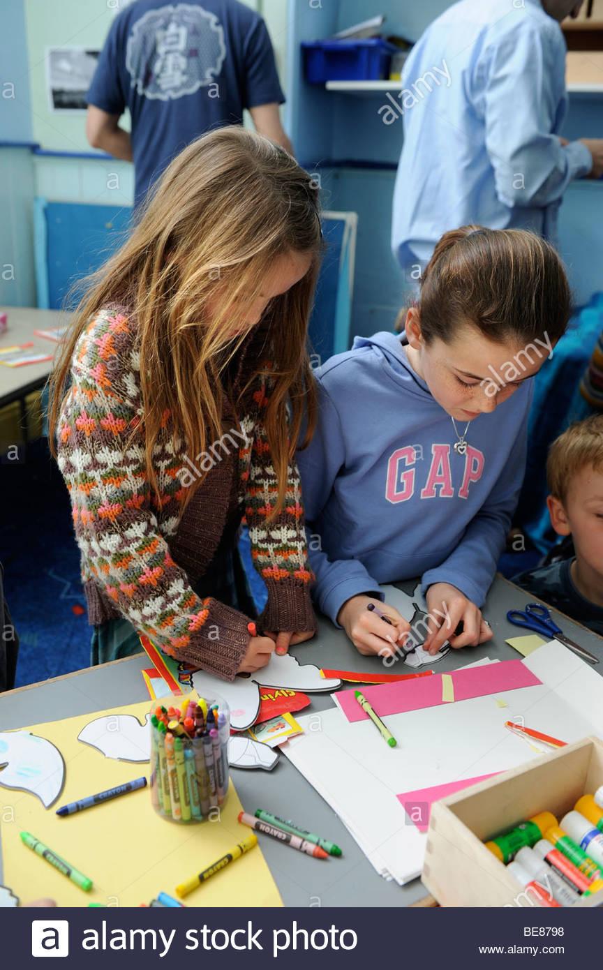 864x1390 Children Drawing Cut Out Butterflies At A Sunday School Uk Stock