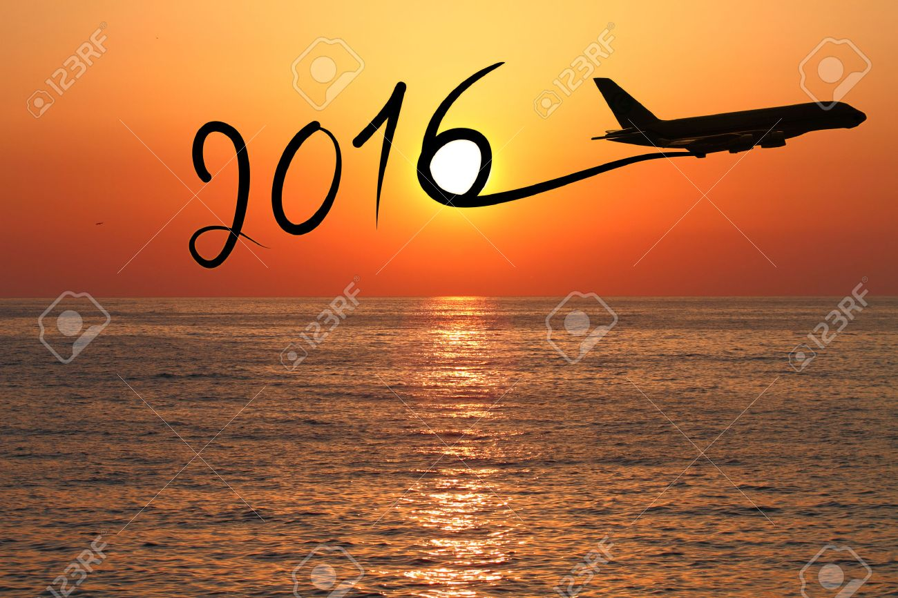 1300x866 New Year 2016 Drawing By Airplane On The Air At Sunset Stock Photo