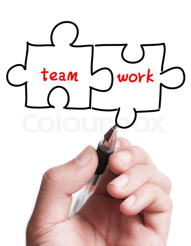 622x800 Businessman Is Drawing A Teamwork Puzzle Concept On