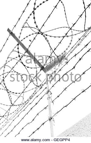 300x470 And Cloudy Sky In Oman Barbwire In The Background Stock Photo
