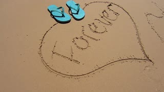 320x180 Pair Of Flip Flops Dropped On Love Heart Drawn In The Sand On