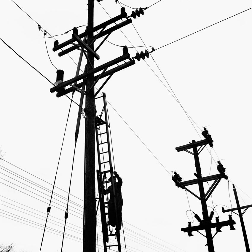 850x850 A Lineman Walking Up A Ladder To Get To The Power Lines. Undated