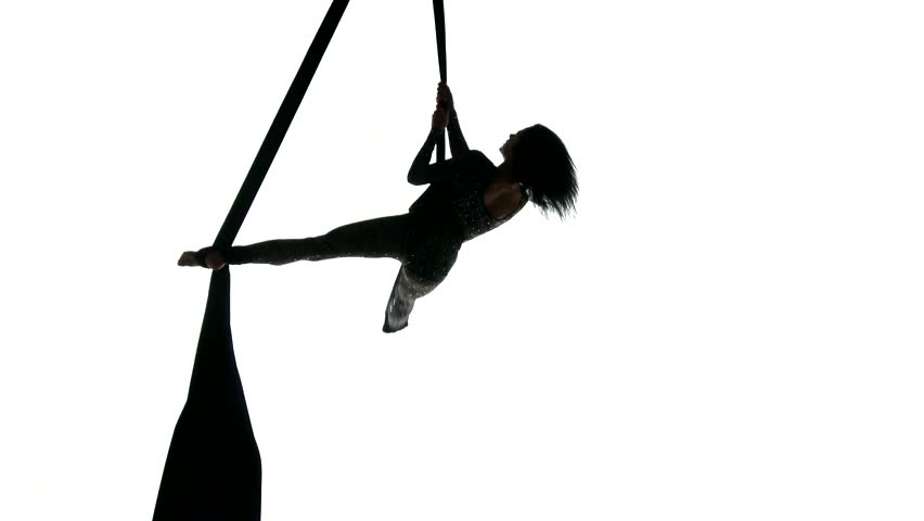 852x480 Aerial Acrobat Woman On Circus Stage. Silhouette On A Blue